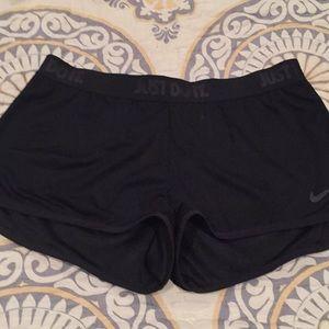 Black mesh Nike shorts